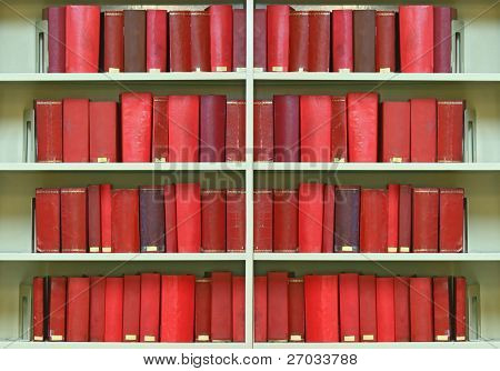 red old hardcover books on shelf