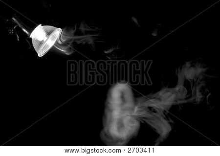 Smoke In Light Of A Lamp. Monochrome