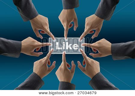 team of businessman push on like button for teamwork concept