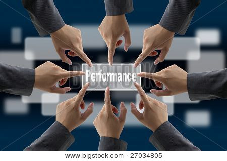 A diverse business team with hands together push Performance button