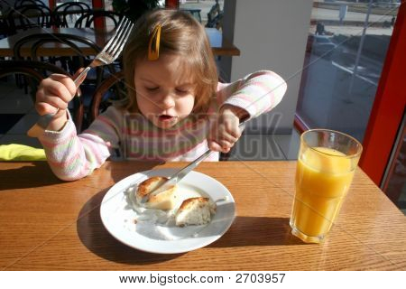 Toddler With Knife And Folk