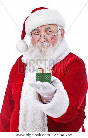 Santa Claus holding and offering a gift on his hand, isolated on white background