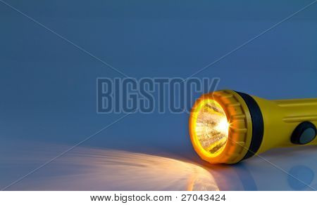 yellow plastic pocket flash-light
