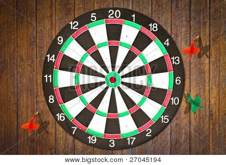 Dartboard on wood wall (miss darts)