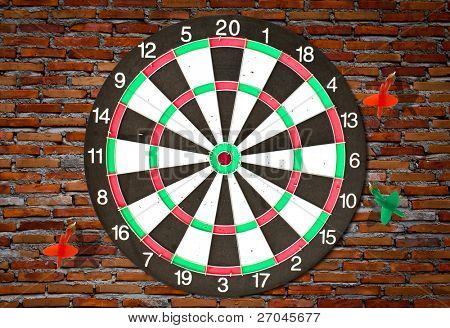 Dartboard on brick wall (miss darts)