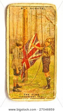 BRITISH UNION - CIRCA 1970: A Postcard printed in the British Union shows image Boy Scout Raise the British Union flag, circa 1970