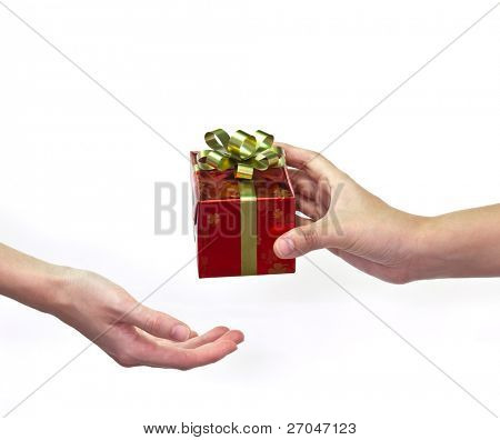 """Give and take""  Gift box on hand to hand isolated on white background."