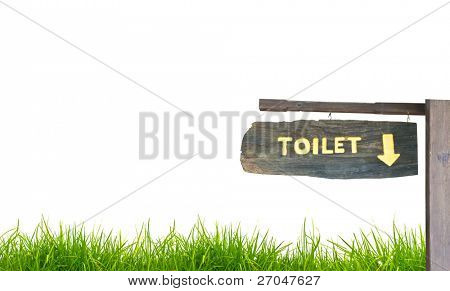 A wooden sign hung over the entrance to a toilet.