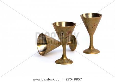 Ancient glass isolated on white background.