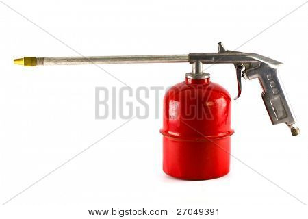 Old red spray gun isolated over white background