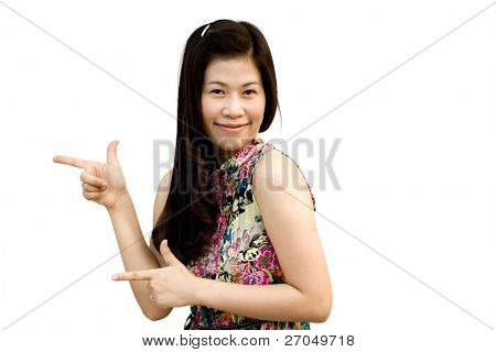 Young girl pointing up, isolated on white background.