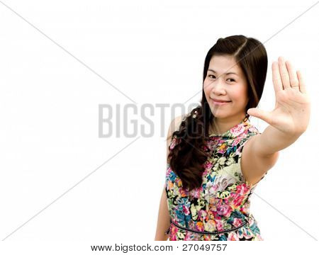 Portrait of a cute young female gesturing a stop sign isolated over white (focus on hand)