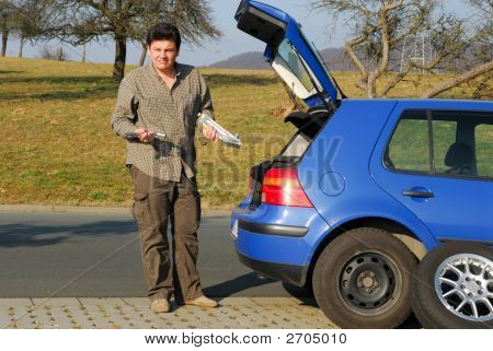 Man Changing A Tire