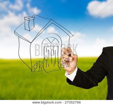 Business hand with pen drawing a house
