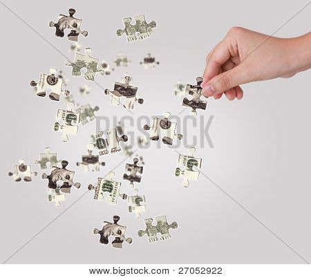 Hands and dollar money puzzle