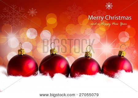 shiny red christmas balls in billowy feathers