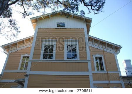 Old yellow villa with white window