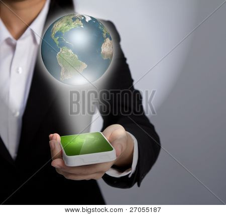 Hand holding a phone show Earth