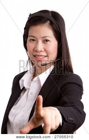 Portrait of business women call center wearing a headset with hand point against white background