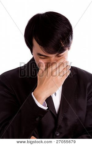 Portrait of  business man depressed from work isolated over white background