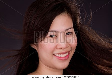 Portrait of young attractive girl with hair in motion
