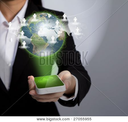 Hand holding a phone show Earth and social network