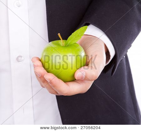 Businessman hand  with a green apple in his hand isolate on white background