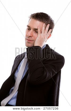 Portrait of a young business man depressed from work against white background
