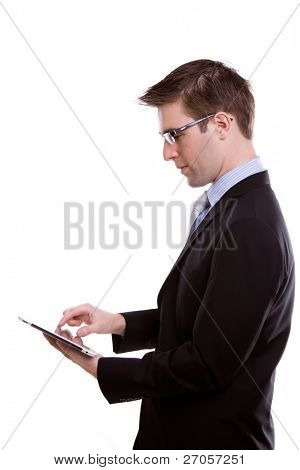Portrait of  young business man using a touch screen device against white background