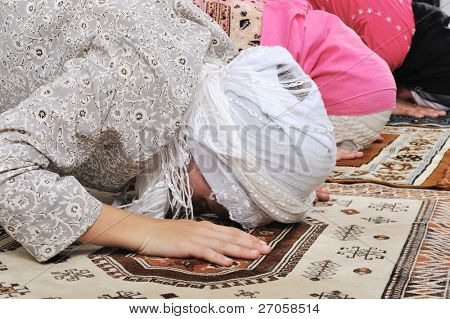 Muslim girls praying at mosque