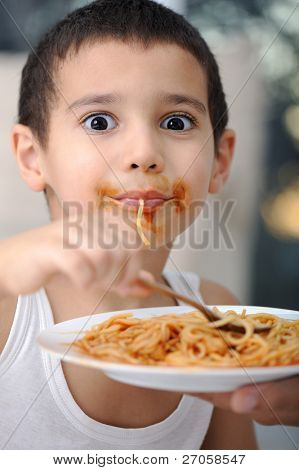 Tasty food, messy child eating spaghetti