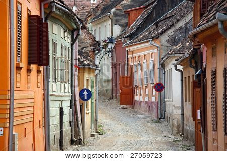 colored street in sighisoara medieval town, romania