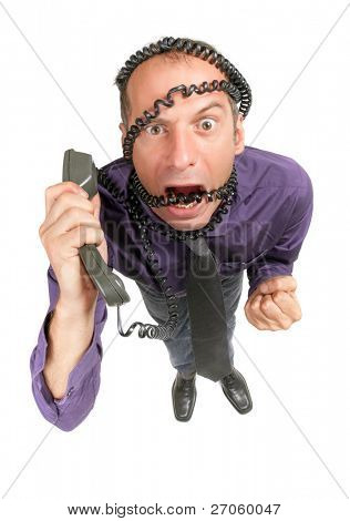 dynamic view of stressed and furious businessman talking on phone