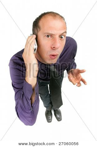 dynamic view of surprised businessman talking on cellular phone
