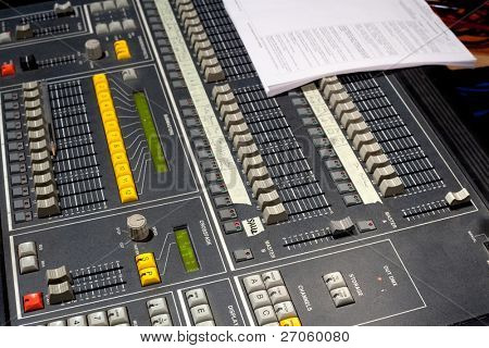 Close up of light or sound mixing board.