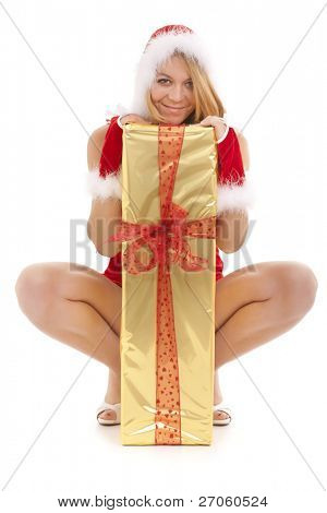 santa girl sitting behind long and big present package