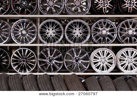 wall of alloy car wheels and pneumatic tires in store