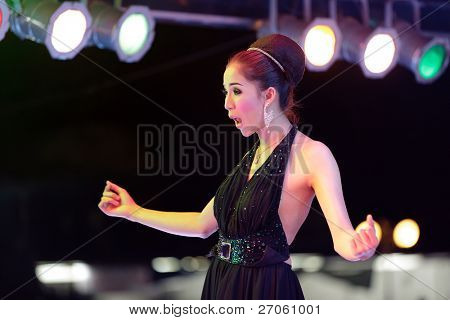transsexual thai singing on stage during night show, pattaya, thailand