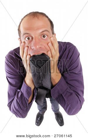 frustrated business man biting his necktie isolated on white
