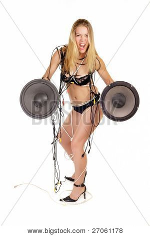 woman in lingerie holding huge stereo woofer isolated on white
