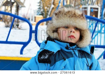 A boy on a winter playground
