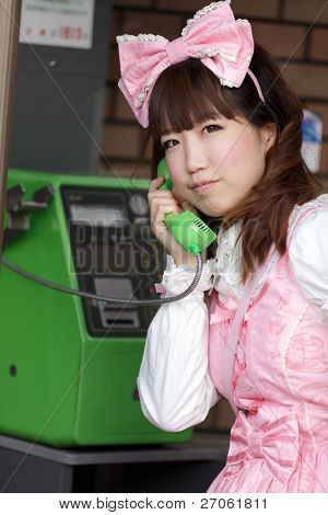 japanese girl in sweet lolita cosplay style phoning, Tokyo