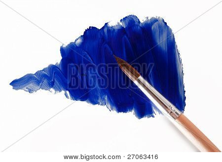 slick blue paint with a brush. isolated on a white background