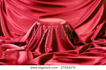 presentation pedestal covered with red silk cloth.