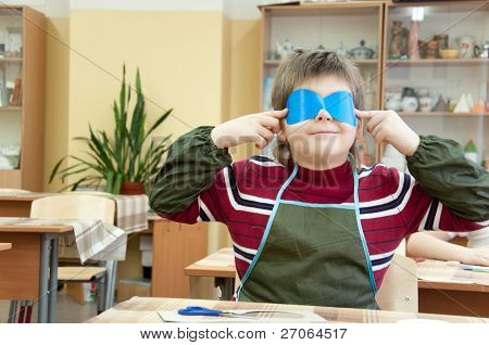 The Boy Makes A Masquerade Mask In Class At School