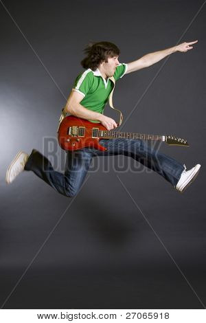 passionate guitarist jumps in the air