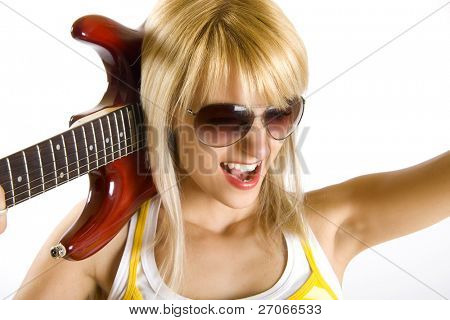 closeup of a woman guitarist holding the guitar on her shoulder