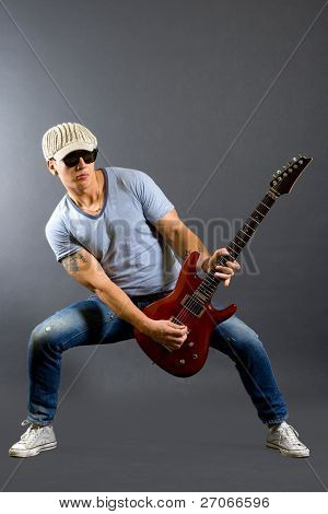 passionate guitarist playing his electric guitar