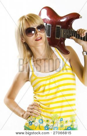 woman guitarist holding the guitar on her shoulder
