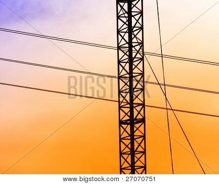 Electric powerlines in sunset